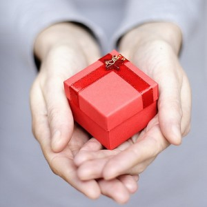 two-hands-holding-a-present-mmlolek-300x300